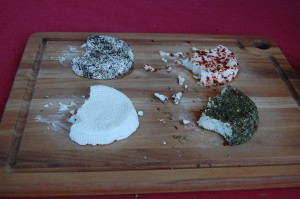 Clockwise starting from top: Peppered chèvre, red pepper chèvre, herbed chevre, and plain